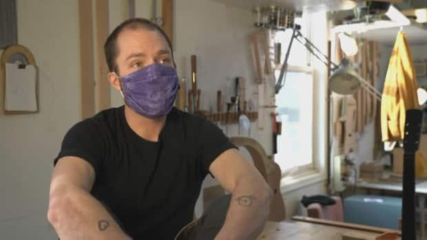 Dion James built his first guitar 15 years ago — at the time, he did not even play the instrument. (Axel Tardieu/CBC - image credit)
