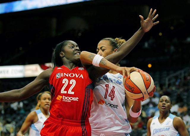 Atlanta Dream's Erika de Souza (14) is fouled by Washington Mystics guard Matee Ajavon (22) in Game 1 of anWNBA basketball Eastern Conference semifinals series, Thursday, Sept. 19, 2013, in Atlanta. (AP Photo/Todd Kirkland)
