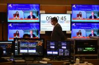 Screens show New Zealand's Prime Minister Jacinda Ardern speaking during the virtual APEC CEO Dialogues 2020, at its command center in Kuala Lumpur