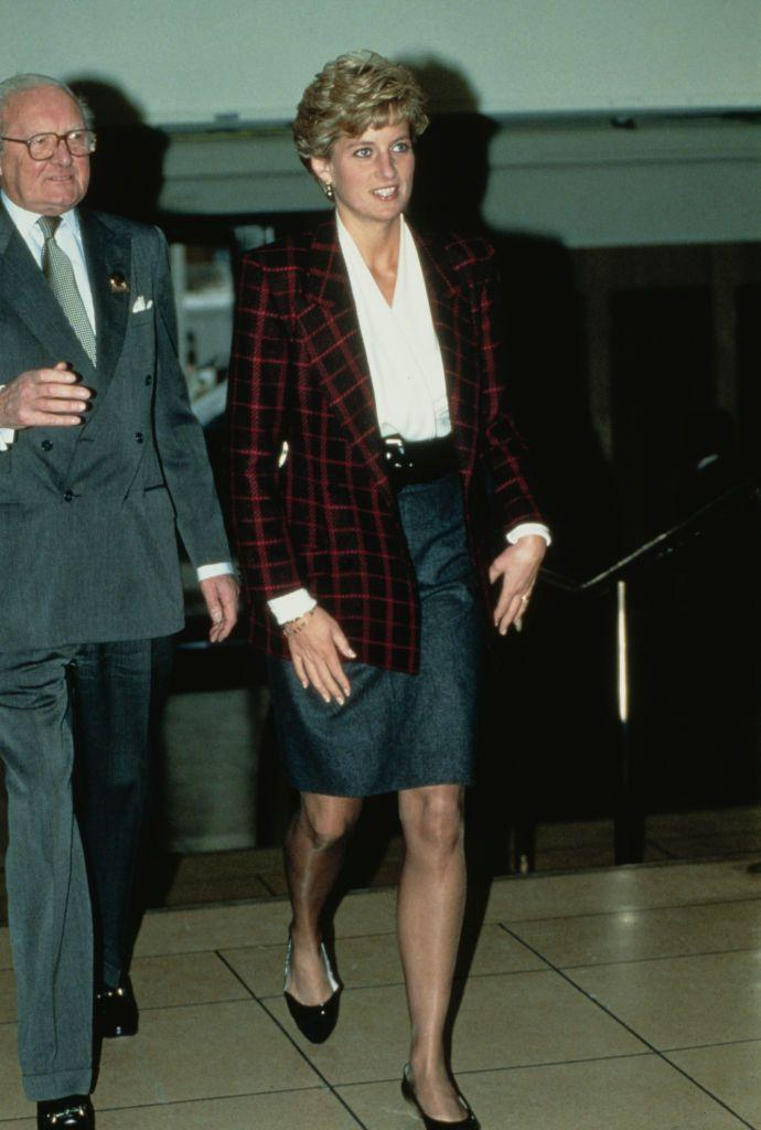 <p>A red check blazer is a perfect choice for the holidays. Diana wore this pick to a horse show during the holiday season in December 1990.<br></p>
