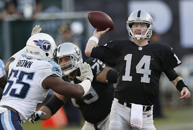 Oakland Raiders quarterback Matt McGloin (14) passes as Tennessee Titans outside linebacker Zach Brown (55) applies pressure during the fourth quarter of an NFL football game in Oakland, Calif., Sunday, Nov. 24, 2013. (AP Photo/Beck Diefenbach)
