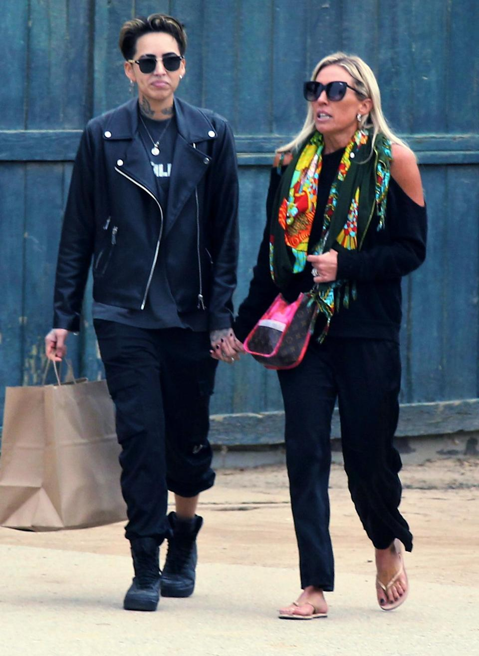 <p><em>Real Housewives of Orange County</em> star Braunwyn Windham-Burke walks hand-in-hand with her girlfriend during a lunch date in Palm Springs on Wednesday.</p>