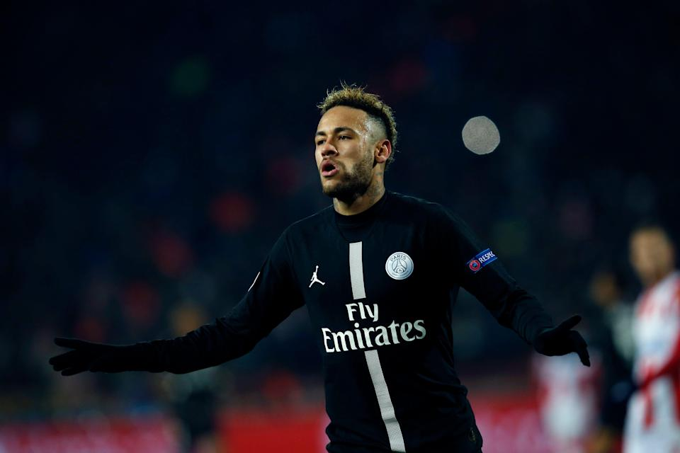 PSG forward Neymar celebrates after scoring his side' second goal during the Champions League group C soccer match between Red Star and Paris Saint Germain, in Belgrade, Serbia, Tuesday, Dec. 11, 2018. (AP Photo/Darko Vojinovic)