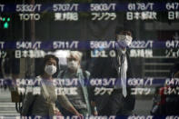 People are reflected on a blank electronic stock board supposedly showing Japan's Nikkei 225 index at a securities firm Thursday, Oct. 1, 2020, in Tokyo. Trading on the Tokyo Stock Exchange was suspended Thursday because of a problem in the system for relaying market information. Most other Asian markets were closed for national holidays. (AP Photo/Eugene Hoshiko)