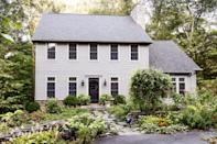 """<p>A black door can still make a bold statement, especially in a shiny, inky shade against soft gray siding.</p><p><a class=""""link rapid-noclick-resp"""" href=""""https://store.benjaminmoore.com/storefront/color-samples/paint-color-samples-1-pint/prodPRM01A.html?sbcColor=2126_10"""" rel=""""nofollow noopener"""" target=""""_blank"""" data-ylk=""""slk:SHOP BLACK PAINT"""">SHOP BLACK PAINT</a></p>"""