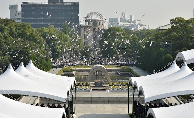Doves fly over the Hiroshima Peace Memorial Park in western Japan on August 6, 2015