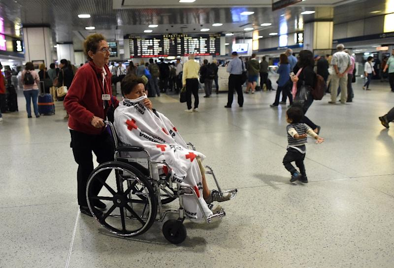 Passengers injured in an Amtrak train derailment who were bused to New York from Philadelphia, pass through Penn Station on May 13, 2015 in New York (AFP Photo/Timothy A. Clary)