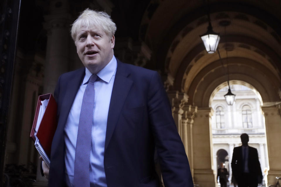 Britain's Prime Minister Boris Johnson returns to Downing Street after attending a Cabinet meeting in London, Tuesday, Oct. 20, 2020. (AP Photo/Kirsty Wigglesworth)