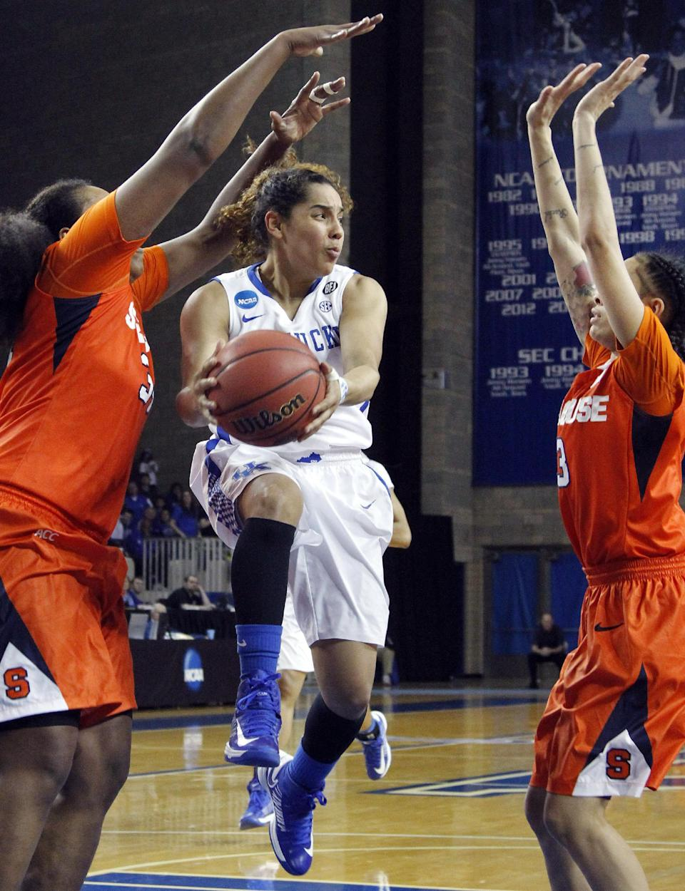Kentucky's Jennifer O'Neill, middle, looks for an open teammate between Syracuse defenders Shakeya Leary, left, and Rachel Coffey during the second half of a second-round game in the NCAA women's college basketball tournament in Lexington, Ky., Monday, March 24, 2014. Kentucky won 64-59. (AP Photo/James Crisp)