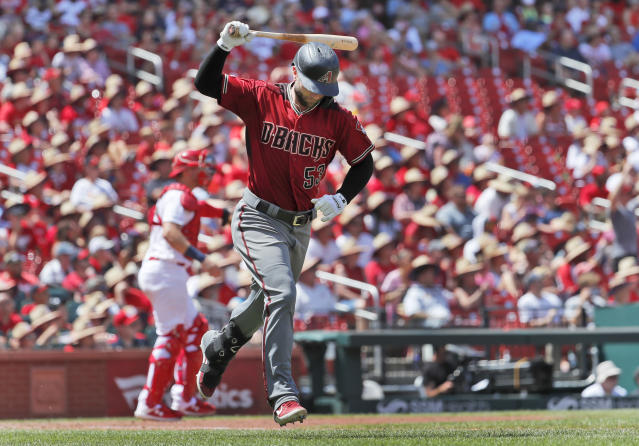 Arizona Diamondbacks' Christian Walker slams down his bat after flying out during the sixth inning of a baseball game against the St. Louis Cardinals Sunday, July 14, 2019, in St. Louis. (AP Photo/Jeff Roberson)