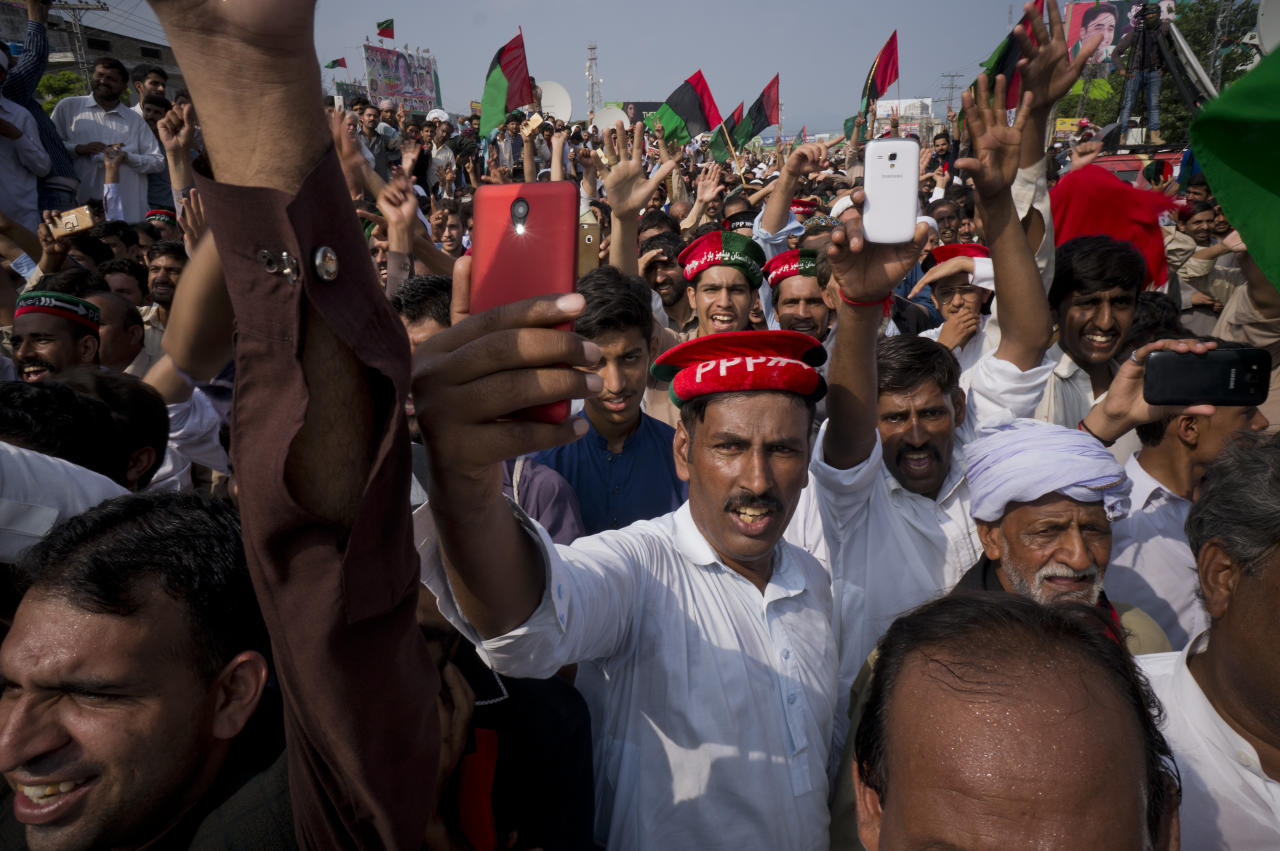 "Supporters of Bilawal Bhutto Zardari, leader of Pakistan Peoples Party, listen to their leader during an election rally in a suburb of Islamabad, Pakistan, Tuesday, July 17, 2018. Pakistan's independent Human Rights Commission warned Monday of ""blatant, aggressive and unabashed"" attempts to manipulate the results of elections set for later this month, with prominent activist I.A. Rehman calling it ""the dirtiest election"" in the country's troubled relationship with democratic rule. (AP Photo/B.K. Bangash)"