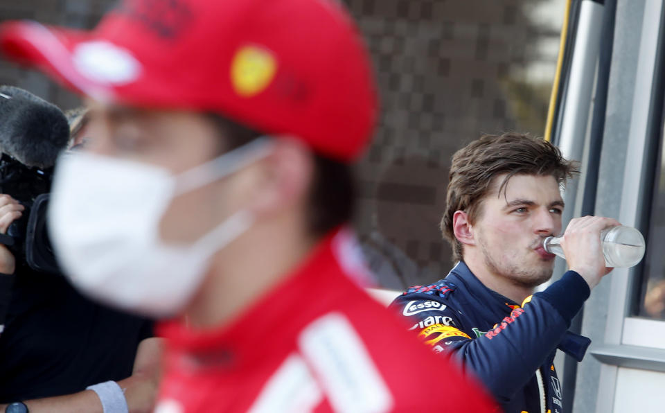 Ferrari driver Charles Leclerc of Monaco, left, and Red Bull driver Max Verstappen of the Netherlands after the qualifying session at the Baku Formula One city circuit in Baku, Azerbaijan, Saturday, June 5, 2021. The Azerbaijan Formula One Grand Prix will take place on Sunday. (Maxim Shemetov, Pool via AP)