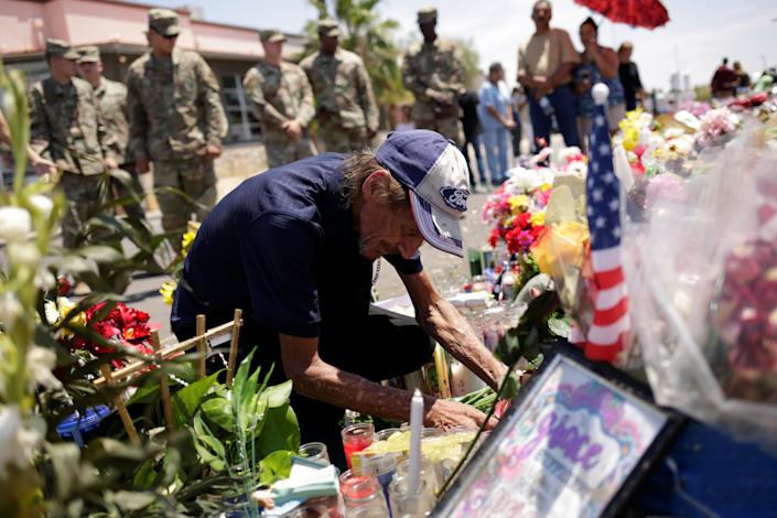Antonio Basco arranges flowers at a memorial for the victims of the shooting in El Paso, Texas, Aug. 15, 2019. Basco's wife, Margie, was killed in the massacre. (Jose Luis Gonzalez/Reuters)