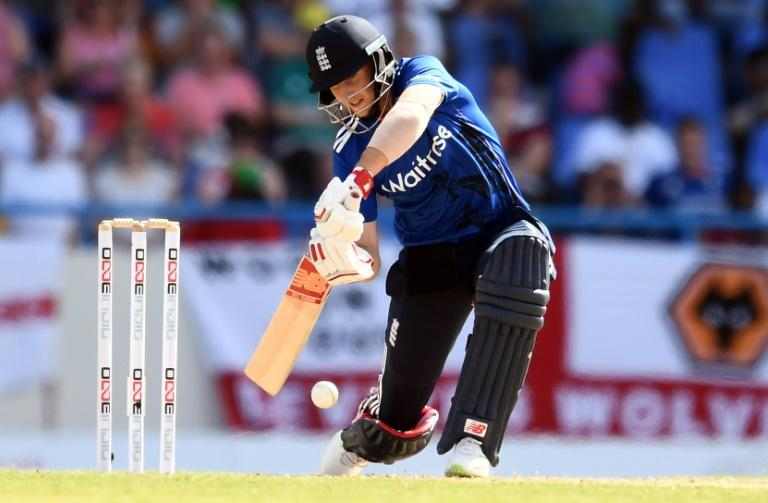 England's cricketer Joe Root plays a shot during the second of the three-match One Day International series between England and West Indies at the Sir Vivian Richards Stadium in St. John's, Antigua, on March 5, 2017