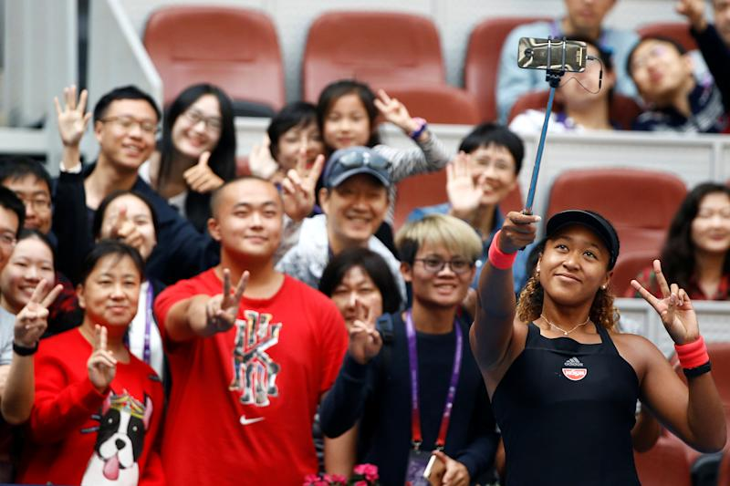 Tennis - China Open - Women's Singles - Third Round - National Tennis Center, Beijing, China - October 4, 2018. Naomi Osaka of Japan takes a selfie with fans after her match against Julia Goerges of Germany. REUTERS/Thomas Peter