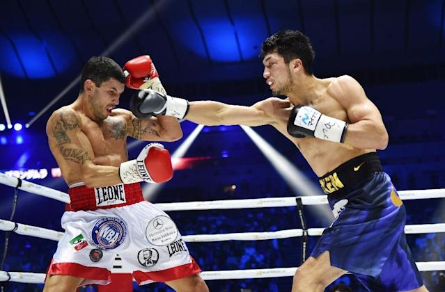 Japan's Ryota Murata, shown right against Italy's Emanuele Blandamura, defends his WBA middleweight title Saturday against American Rob Brant (AFP Photo/Kazuhiro NOGI)