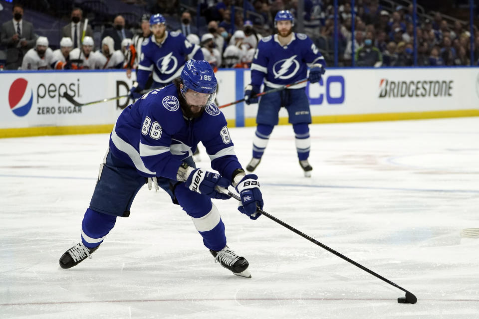 FILE - In this June 25, 2021, file photo, Tampa Bay Lightning right wing Nikita Kucherov (86) moves the puck against the New York Islanders during the second period in Game 7 of an NHL hockey Stanley Cup semifinal playoff series in Tampa, Fla. (AP Photo/Chris O'Meara, File)