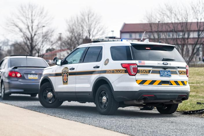 Highway 83 north sign in Pennsylvania with car stopped by police state trooper (Getty Images)