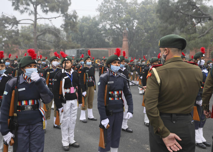 An Army instructor briefs national Cadet Corp students as they prepare for the upcoming Republic Day parade at the Raisina hills, the government seat of power, in New Delhi, India, Monday, Jan. 18, 2021. Republic Day marks the anniversary of the adoption of the country's constitution on Jan. 26, 1950. Thousands congregate on Rajpath, a ceremonial boulevard in New Delhi, to watch a flamboyant display of the country's military power and cultural diversity. (AP Photo/Manish Swarup)