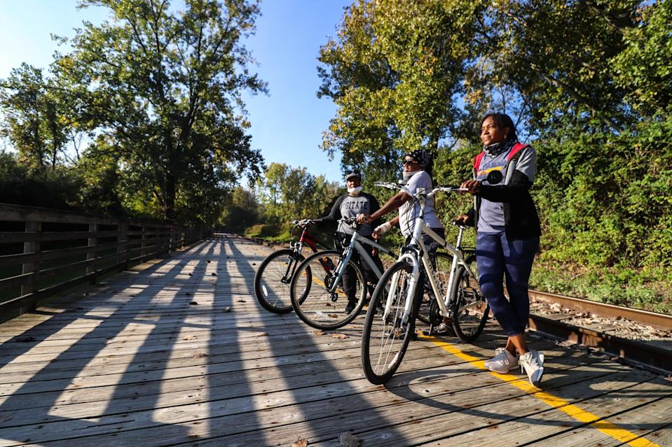 Erika, Marcia and Ebony Hood prepare to lead a group cycling event at the Cuyahoga Valley Scenic Railroad's Rockside Station in September 2020.