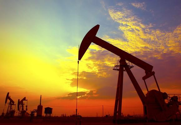 An oil-pumping unit at sunset.