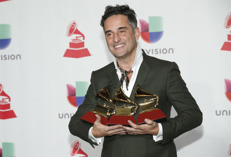 """Jorge Drexler poses in the press room with the awards for best singer-songwriter album for """"Salvavidas De Hielo,"""" song of the year and record of the year for """"Telefonia"""" at the Latin Grammy Awards on Thursday, Nov. 15, 2018, at the MGM Grand Garden Arena in Las Vegas. (Photo by Eric Jamison/Invision/AP)"""