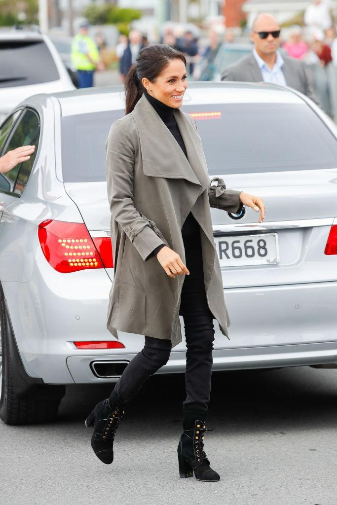 <p>The Duke and Duchess of Sussex headed to Marenui Cafe in Wellington on October 29. For the outing, Meghan wore a £232 Club Monaco trench with £576 Stuart Weitzman boots. <em>[Photo: Getty]</em> </p>