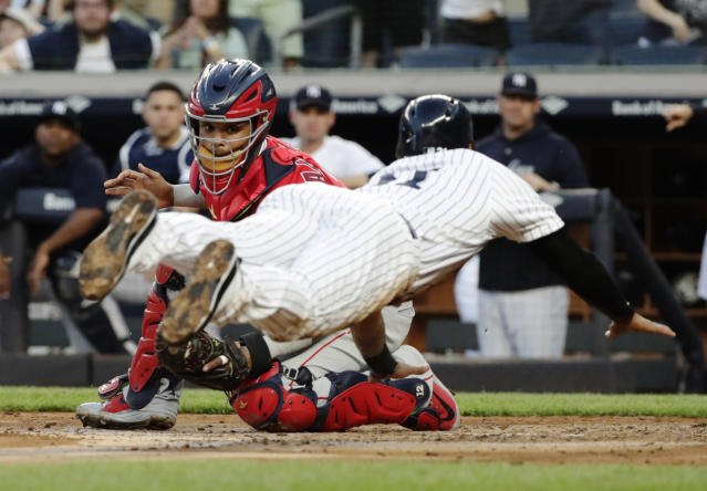 Los Angeles Angels catcher Martin Maldonado, left, tags out New York Yankees' Aaron Hicks at home plate during the second inning of a baseball game Friday, May 25, 2018, in New York. (AP Photo/Frank Franklin II)