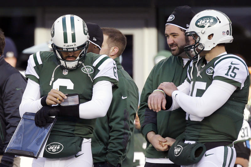 New York Jets quarterbacks Mark Sanchez (6) and Tim Tebow (15) stand next to each other on the sideline during the first half of an NFL football game against the San Diego Chargers, Sunday, Dec. 23, 2012, in East Rutherford, N.J. (AP Photo/Kathy Willens)