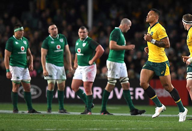Rugby Union - June Internationals - Australia vs Ireland - Sydney Football Stadium, Sydney, Australia - June 23, 2018 - Israel Folau of Australia is watched by players from Ireland as he runs off the field after receiving a yellow card. AAP/David Moir/via REUTERS ATTENTION EDITORS - THIS IMAGE WAS PROVIDED BY A THIRD PARTY. NO RESALES. NO ARCHIVE. AUSTRALIA OUT. NEW ZEALAND OUT.