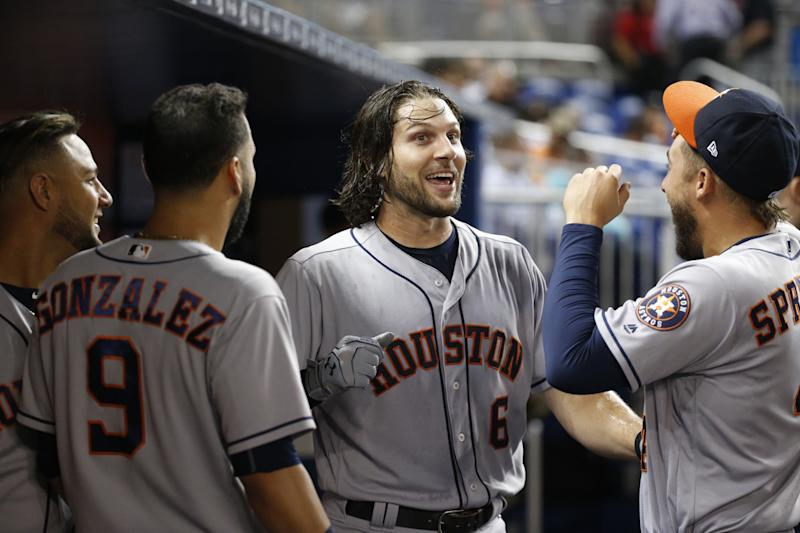 Jake Marisnick (center) hit two homers off the Marlins home-run sculpture. (AP)