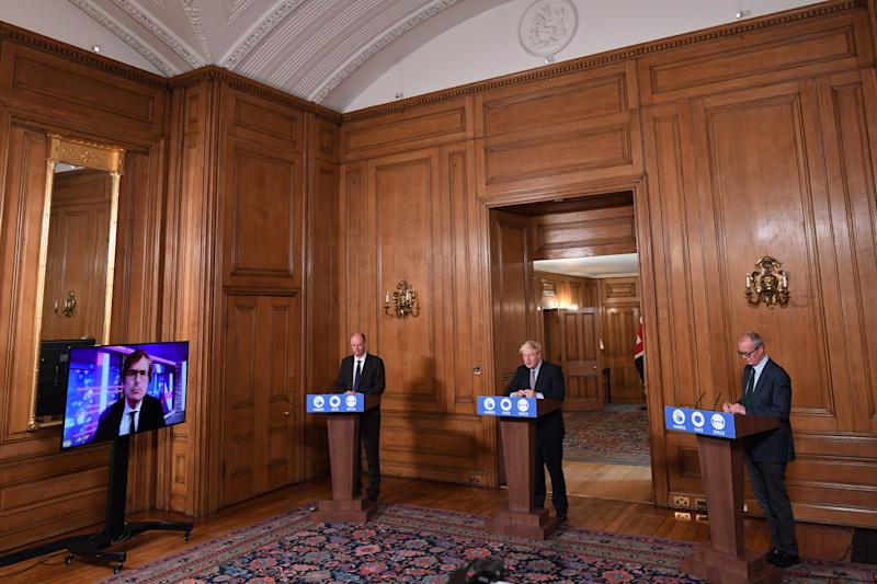 (left to right) Chief Medical Officer Professor Chris Witty, Prime Minister Boris Johnson and Chief Scientific Adviser Sir Patrick Vallance during a virtual press conference at Downing Street, London, following the announcement that the legal limit on social gatherings is set to be reduced from 30 people to six. The change in the law in England will come into force on Monday as the Government seeks to curb the rise in coronavirus cases.