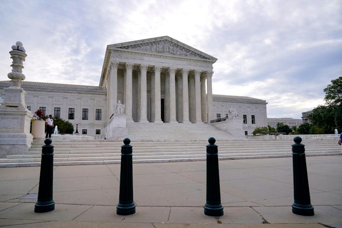 In this Oct. 4, 2021 photo, the Supreme Court is seen on the first day of the new term, in Washington.