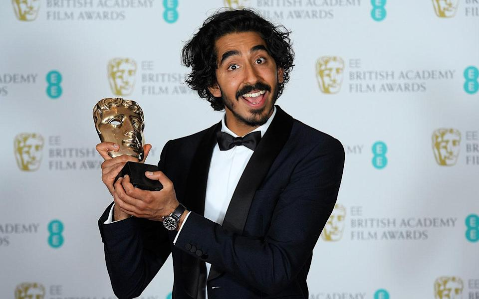 Dev Patel holds the award for best Supporting Actor, 'Lion' at the British Academy of Film and Television Awards (BAFTA) at the Royal Albert Hall in London, Britain, February 12, 2017. (REUTERS/Toby Melville)
