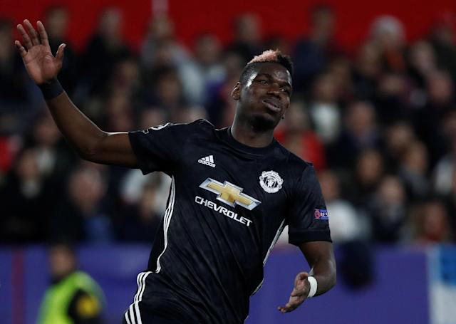 Soccer Football - Champions League Round of 16 First Leg - Sevilla vs Manchester United - Ramon Sanchez Pizjuan, Seville, Spain - February 21, 2018 Manchester United's Paul Pogba reacts REUTERS/Juan Medina