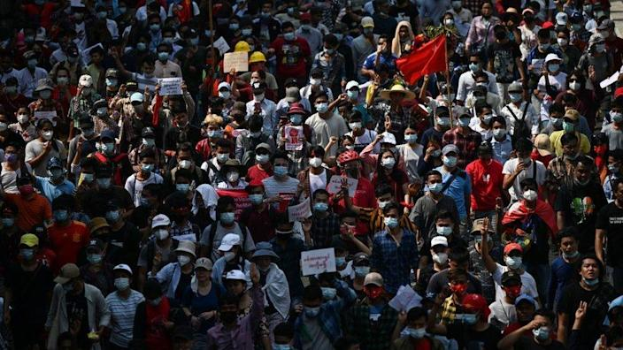 Protesters march during a demonstration against the military coup in Yangon