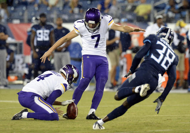 Minnesota Vikings kicker Daniel Carlson (7) kicks a 39-yard field goal as Tennessee Titans defender Kenneth Durden (38) rushes in the first half of a preseason NFL football game Thursday, Aug. 30, 2018, in Nashville, Tenn. Holding is Ryan Quigley (4). (AP Photo/Mark Zaleski)