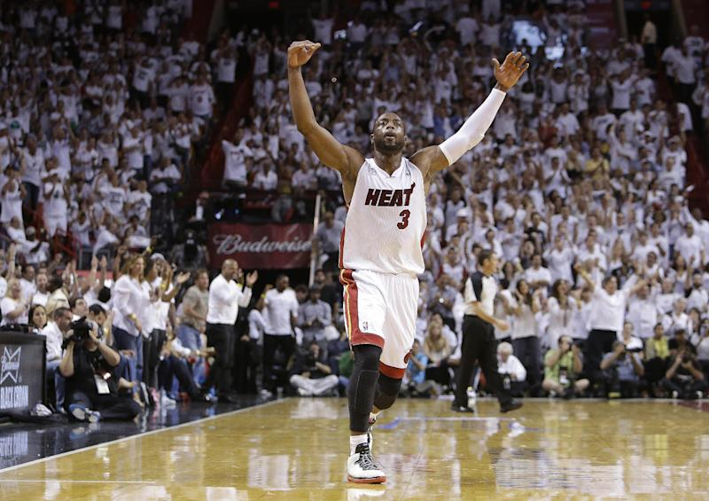 Miami Heat shooting guard Dwyane Wade (3) reacts to play against the Indiana Pacers during the second half of Game 7 in their NBA basketball Eastern Conference finals playoff series, Monday, June 3, 2013 in Miami. (AP Photo/Lynne Sladky)