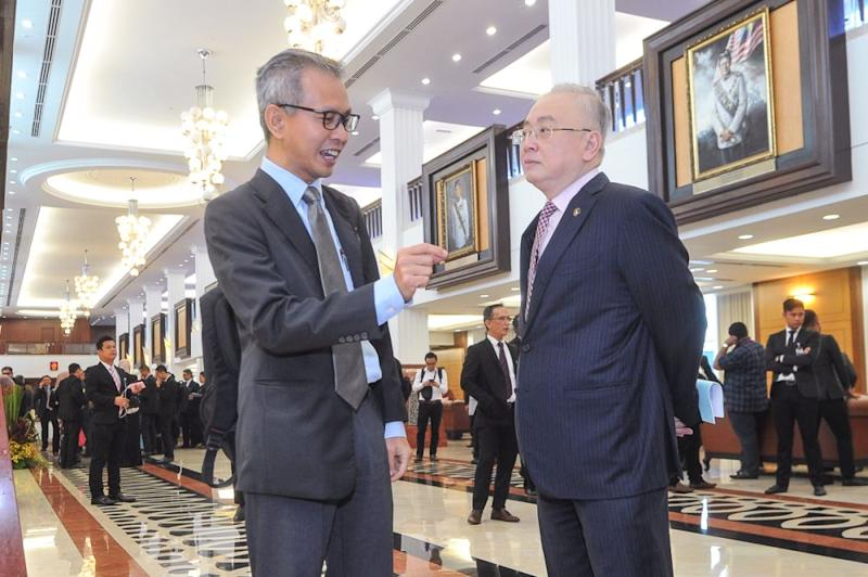 Pua (left) said it was untenable for Najib to claim not to know that RM9 billion budget the latter previously announced for the project only covered basic construction costs and not any form of acquisition. — Picture by Shafwan Zaidon