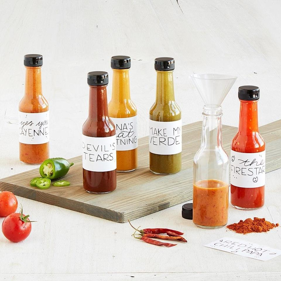 <p>This <span>Make Your Own Hot Sauce Kit</span> ($40) is a fun gift.</p>