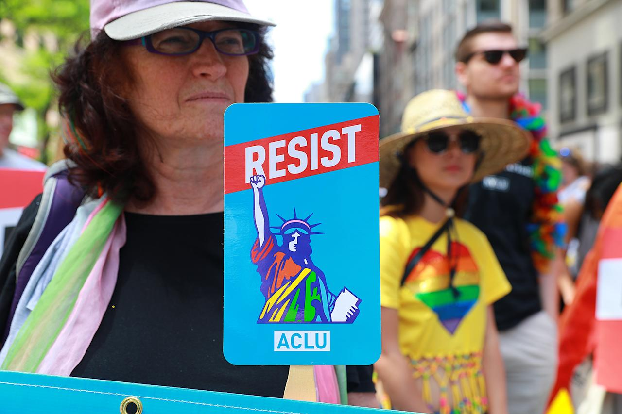 <p>A woman holds up a resist signs before the start of the N.Y.C. Pride Parade in New York on June 25, 2017. (Photo: Gordon Donovan/Yahoo News) </p>