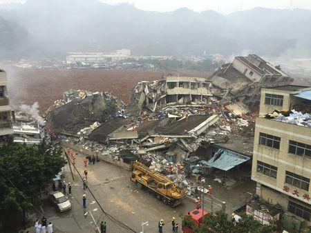 Damaged buildings are seen as rescuers search for survivors after a landslide hit an industrial park in Shenzhen, Guangdong province, China, December 20, 2015. REUTERS/China Daily