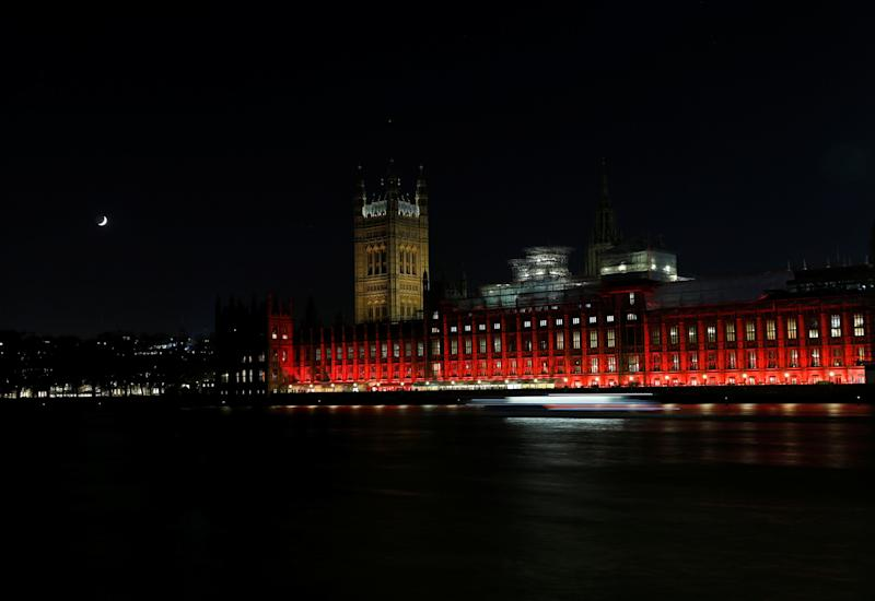 The Houses of Parliament in Westminster are floodlit in red light to mark #RedWednesday on Nov. 22 in London, England.
