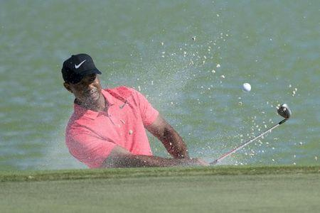 Tiger Woods hits out of the bunker on the ninth hole during the final round of the Hero World Challenge golf tournament at Albany. Mandatory Credit: Kyle Terada-USA TODAY Sports
