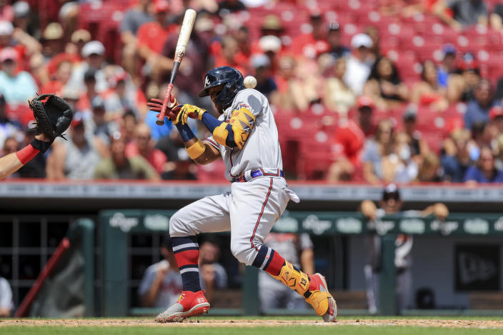 Atlanta Braves' Ronald Acuna Jr. reacts as he avoids a pitch during the fifth inning of a baseball game against the Cincinnati Reds in Cincinnati, Sunday, June 27, 2021. (AP Photo/Aaron Doster)