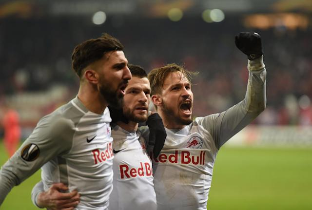 Soccer Football - Europa League Round of 32 Second Leg - RB Salzburg vs Real Sociedad - Red Bull Arena Salzburg, Salzburg, Austria - February 22, 2018 RB Salzburg's Moanes Dabour, Valon Berisha and Andreas Ulmer celebrate at the end of the match REUTERS/Andreas Gebert