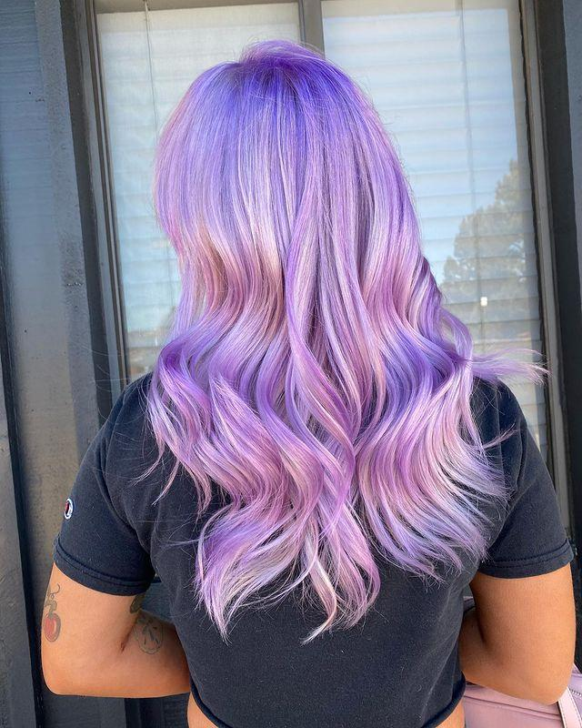 """<p>Lilac hair doesn't have to be soft if you don't want it to be. Add vibrance by using different shades of purple to give dimension.</p><p><a href=""""https://www.instagram.com/p/COQnhsKDwaL/"""" rel=""""nofollow noopener"""" target=""""_blank"""" data-ylk=""""slk:See the original post on Instagram"""" class=""""link rapid-noclick-resp"""">See the original post on Instagram</a></p>"""