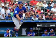 Feb 28, 2019; Jupiter, FL, USA; New York Mets infielder Pete Alonso (20) connects for a base hit against the St. Louis Cardinals at Roger Dean Chevrolet Stadium. Mandatory Credit: Steve Mitchell-USA TODAY Sports