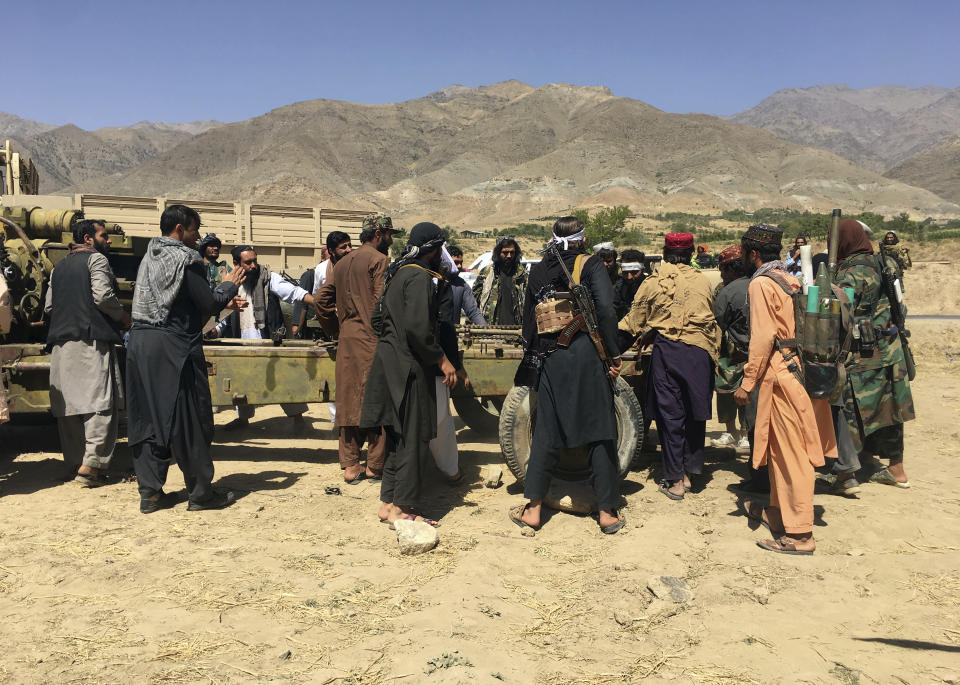Taliban soldiers gather with weapons and machinery in Panjshir province northeastern of Afghanistan, Wednesday, Sept. 8, 2021. (AP Photo/Mohammad Asif Khan)