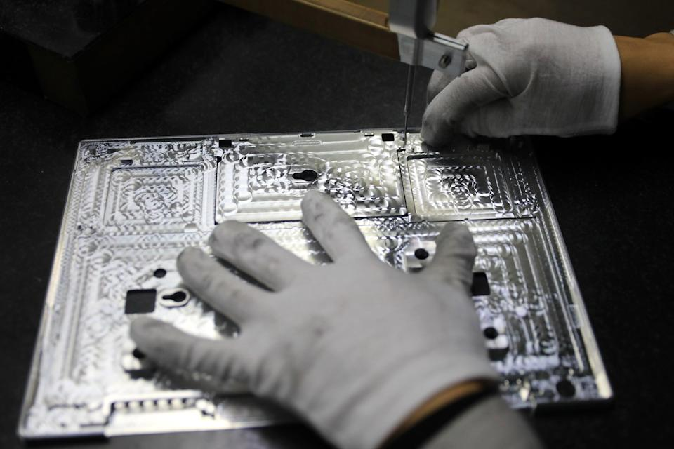 A worker checking laptop parts at a Chinese semiconductor factory  (AFP via Getty Images)